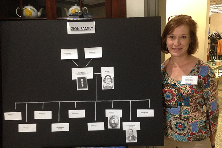Genealogist Roberta Martin displays the Zion family tree at the SullivanMunce Cultural Center on June 6 during the Global Family Reunion. (Photo by Mark Ambrogi)