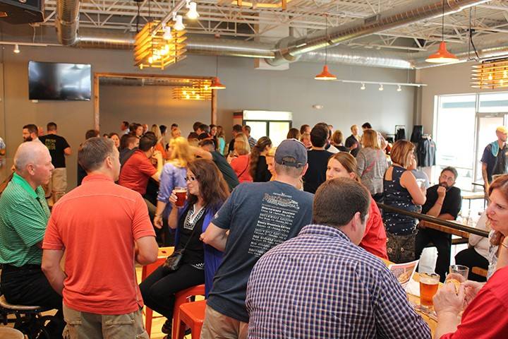 Customers gather at the Sun King friends and family event on June 29. (Photo by James Feichtner)