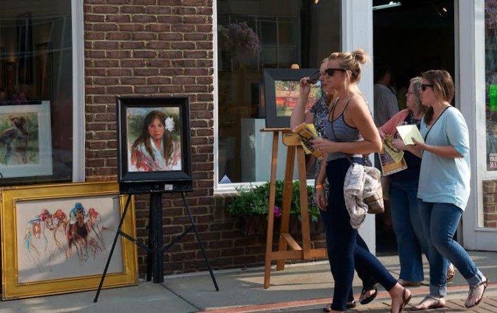Locals walk through downtown Carmel during last year's Art of Wine. (File photo)