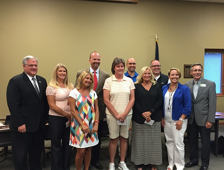 School representatives Clint Cushman (Thorpe Creek Elementary), Deb Jackson (New Britton Elementary), Rod Sutherlin(Geist Elementary), Tara Bertrum(Harrison Parkway Elementary) and Jaime Spears(Fall Creek Elementary) with HSE School Board President John DeLucia and HSE Superintendent Dr. Allen Bourff. (Photo by James Feichtner)