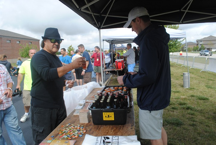 Roberto Chavez of cover band Skeeter McGee gets a beer sample from Kevin Clay of Bells Brewery.
