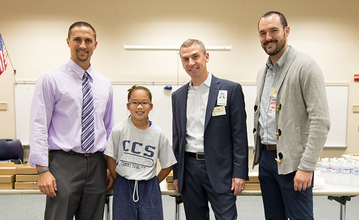 Bob Loy, from left, is the September Teacher of the Month. Student Melissa Su nominated him. Jim Griffith and Jason Riley from sponsor Market District helped honor Loy on Sept. 30. (Photo by Feel Good Now)
