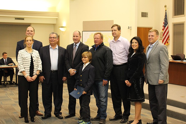 Mayor Fadness and city council members honor Fishers resident Ethan McKinney at the Oct. 19 city council meeting. (Photo by James Feichtner)