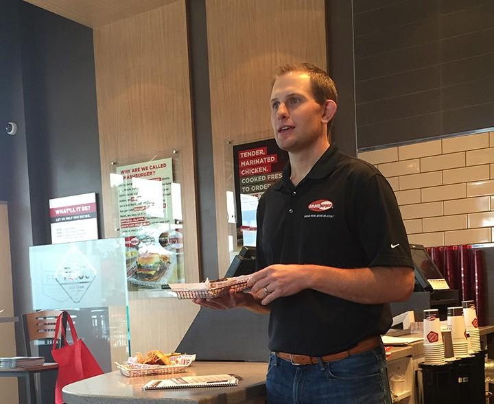 Adam Passarelli, senior director of marketing, presents the new Smashburger restaurant in Westfield. (Photo by Anna Skinner)