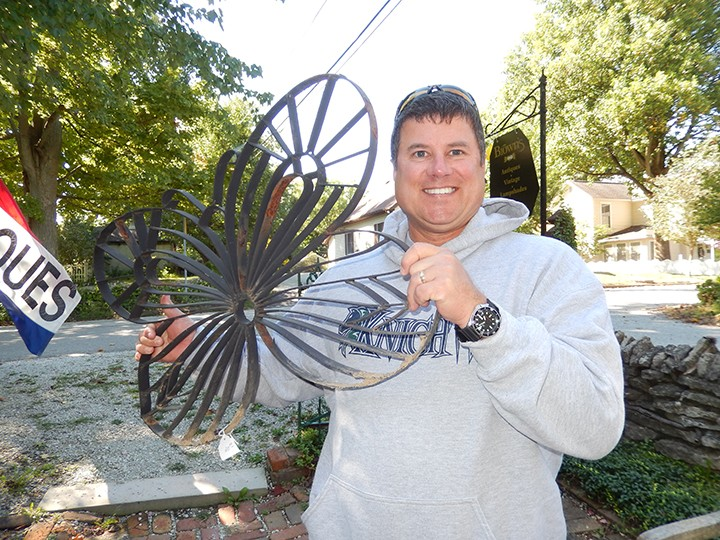 Mike Farley bought a metal butterfly for his wife, Martha. (Photo by Donna Monday)