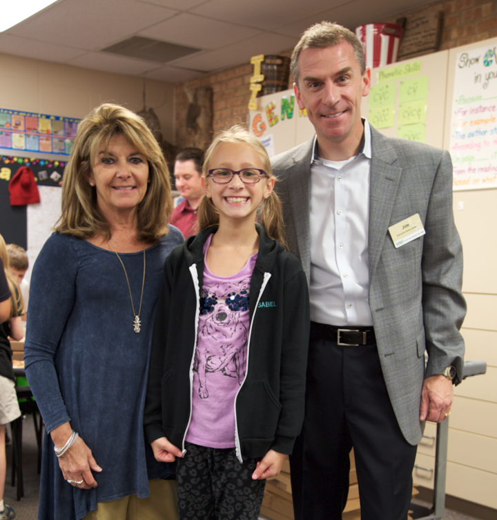 Eagle Elementary fourth grade teacher Jayne Shubat, left, won Current's Teacher of the Month honor for September. Student Izzy Casciani nominated her. Jim Griffith, the executive store leader at Market District, presented Shubat with a gift card. (Photo by Feel Good Now)