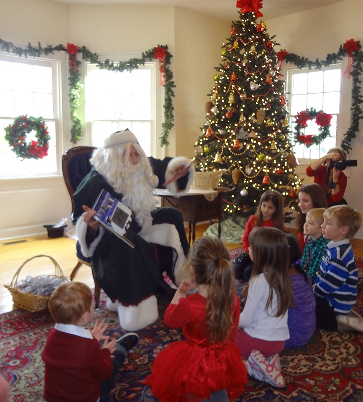 Santa reads to kids during the 2014 Ambassador House Victorian Christmas. (Submitted photo)