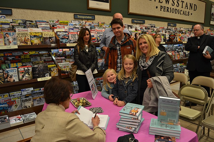 Elaine Jannetides signs a book for fans. (Submitted photo)