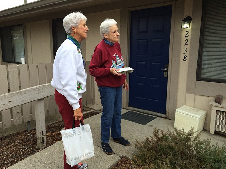 Pat Wolfert, left, and Claire Campbell deliver food on their Meals on Wheels route. (Photo by Mark Ambrogi)