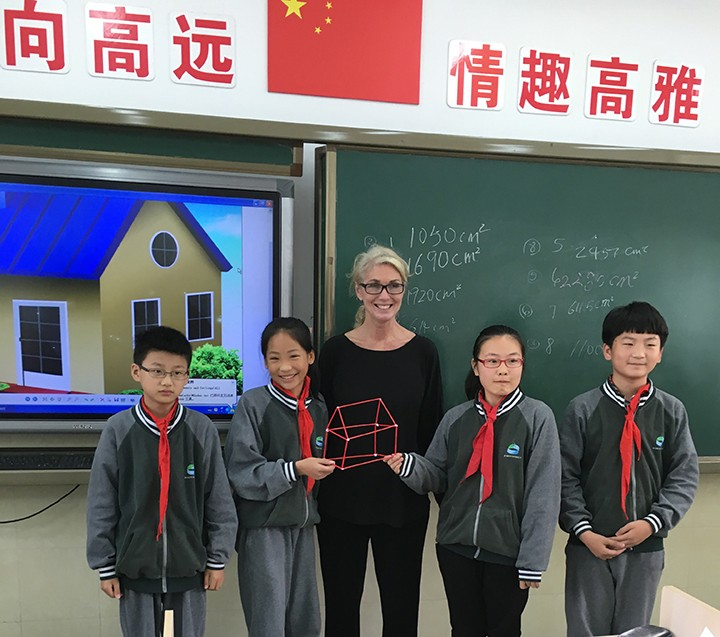 In Beijing, China, HSE teacher Holly Miller holds a Chinese student constructed project from one of Miller's lesson plans. (Submitted photo)