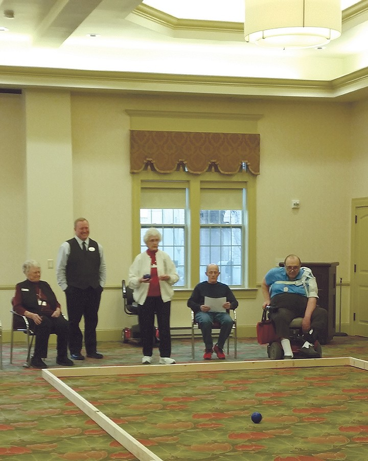 Residents at The Barrington of Carmel play bocce ball during their first week of Living It! The game allowed for those unable to stand to participate while sitting. (Submitted photo)