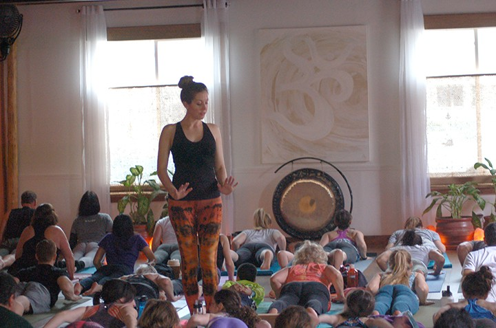 Co-founder Lily Kessler teaches a birthday yoga class on the anniversary of the studio's opening. (Photos by Heather Lusk)