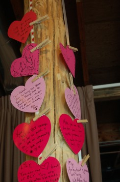 Hearts show appreciation for the many Blooming Life Yoga teachers hang from posts in the studio.