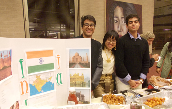 Students from the World Connections Club at HSEHS display information about and share food from India during last year's International Night event. (Submitted photo)