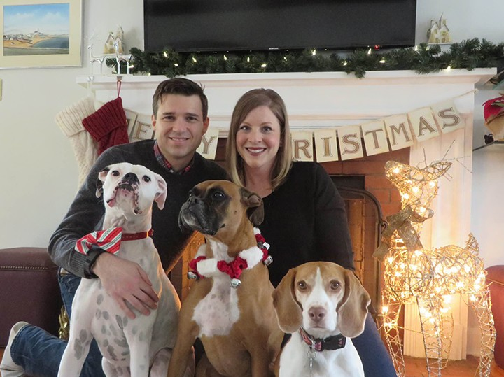 Brett and Christy Zeller with their three dogs Simon, Bailey and Trudy. (Submitted photo)