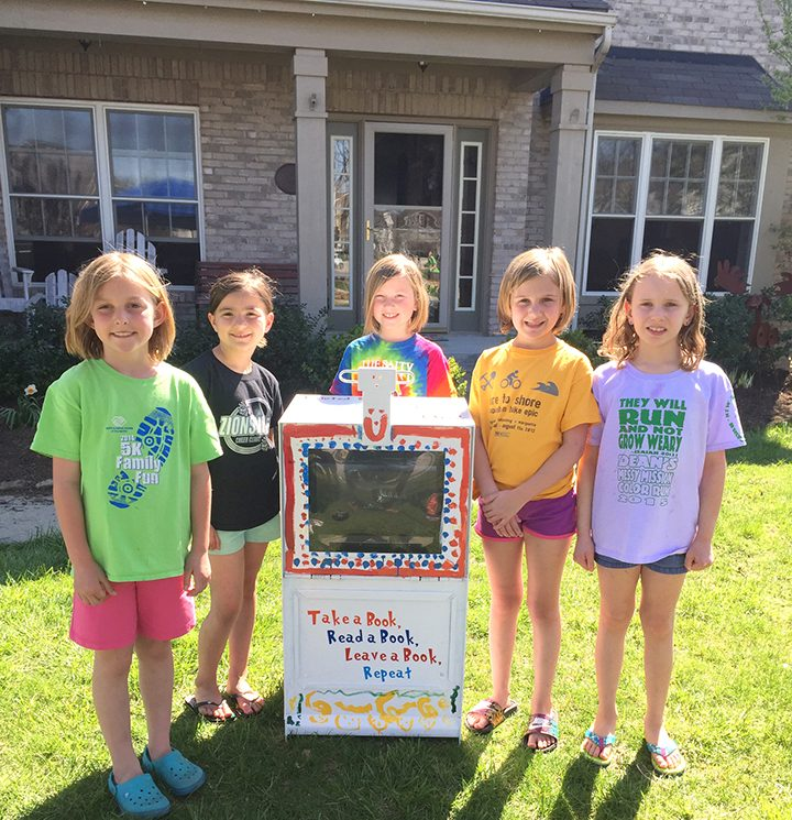 Allie Buroker, Maddie Jenkins, Cameron Kraft, Taylor Kane and Stella Coulson with Brownie Troop 1362 painted Rock Bridge's Little Free Library. (Submitted photo)
