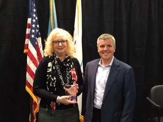 Navient President and CEO Jack Remondi presents Julie Lee with the company's Navigator Leadership Award. (Submitted photo)