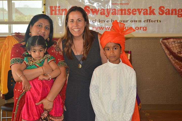 Geeta Ganthi holds Akshara Purumundla alongside Prairie Trace Elementary schoolteacher Heather Monger and student Akshay Purumundla. (Submitted photo)