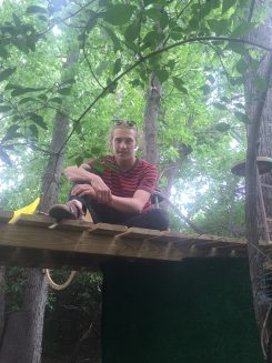 Scott Osborne takes a break in his treehouse at IUPUI. (Photo by Adam Aasen)