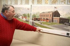 Clay Township trustee Doug Callahan points out a rendering of Fire Station 44, which he helped rebuild. (Photo by Feel Good Now)