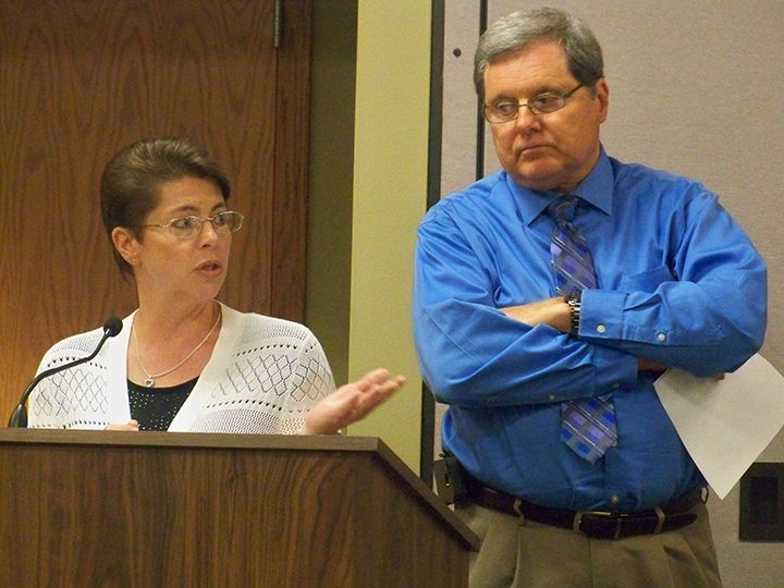 Hamilton Southeastern Schools Business Manager Cecilie Nunn and Director of Transportation Jim White present their report to the school board proposing to enter a lease-purchase agreement for 35 new school buses before next school year. (Photo by Sam Elliott)