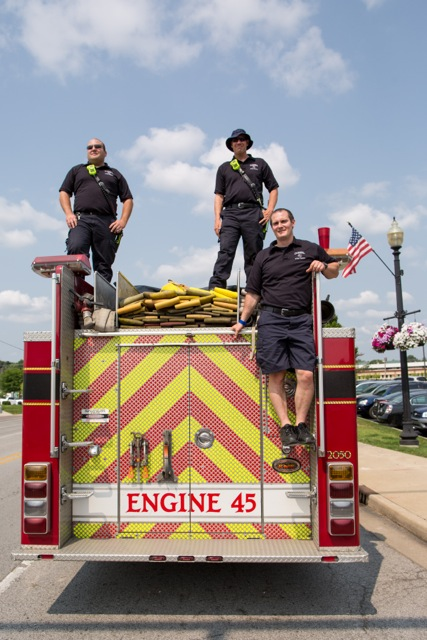 From left, Carmel Fire Dept. Engineer Michael DeLong, Lt. Ted Lenze and firefighter Marcus Nalley rest on a truck at the 2015 CarmelFest. (Submitted photo)