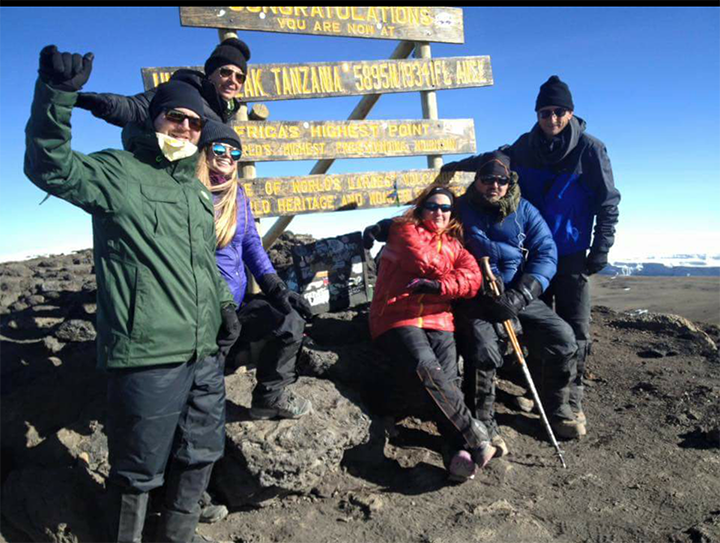 From left, Chris Wallace of Indianapolis, Olivia Anderson of Atlanta, Ga., Angela Griffith of Atlanta, Andrea Ryan of Carmel, Bill Ryan of Carmel and Brian Debshaw of Zionsville at the summit of Mount Kilimanjaro. (Submitted photo)