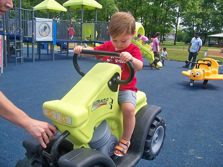 Cameron Carden enjoys one of the new Holland Park toddler playground features. (Photo by Sam Elliott)