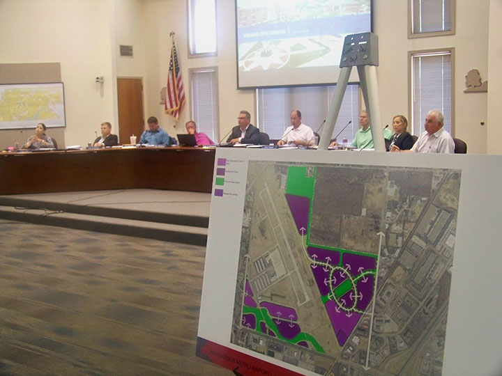 A map depicting the city's new plan for development of land at the airport is on display at the July Fishers City Council meeting. (Photo by Sam Elliott) CIF-Brandon Dickinson — Fishers' Director of Economic Development Brandon Dickinson addresses the city council at its July meeting. (Photo by Sam Elliott)