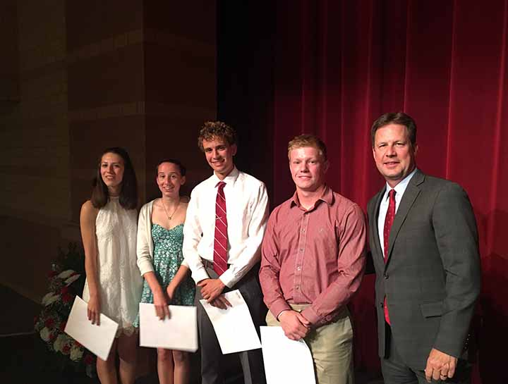 From left, FHS seniors Megan Forbes, Lorinda Kirk, Daniel Greiwe and Michael Folta with TigerONE President Joe Eaton, who presented the students with $500 scholarships from the booster club. (Submitted photo)