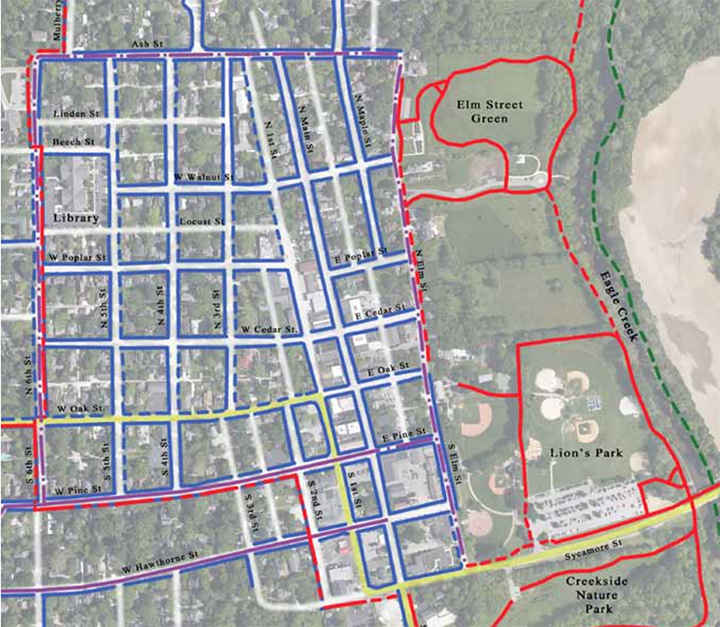This map of downtown Zionsville shows changes that could be made a result of the Strategic Trails and Implementation Plan. The solid, red lines show existing pathways, and the dotted, red lines show proposed multi-use pathways. Solid, blue lines show existing sidewalks, and dotted blue lines show proposed sidewalks. Solid purple lines show existing shared lanes, and dotted purple lines show proposed bike lanes or shared lanes. The dotted green line shows a proposed greenway, and the solid yellow line shows existing interstate and highway. (Submitted map)
