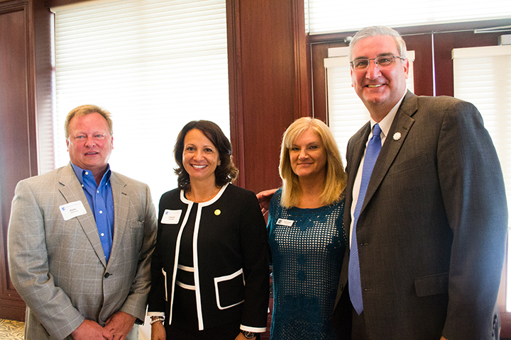 From left, Pete Peterson, Laura Campbell, Kim Good and Eric Holcomb gather at the Bridgewater club after a GOP breakfast July 13. Holcomb was a last-minute guest speaker for the GOP breakfast after he took the place of Gov. Mike Pence. (Photo by Jason Conerly)