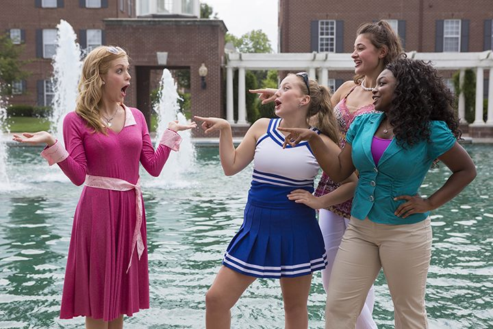 From left: Claire Cassidy, of Fishers, who plays Elle Woods, Fishers, Marissa Tappy, of Noblesville, who plays Serena, Tiana Williams, of Indianapolis, who plays Pilar, and  Katelyn Soards, of Zionsville, who plays Margot, act out a scene in front of The Center for the Performing Arts. (Submitted photo)