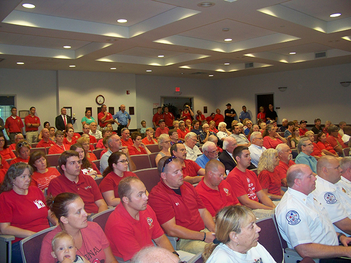 A red-clad crowd in support of Lawrence's EMS personnel attended the common council's Aug. 1 meeting. (Photo by Sam Elliott)
