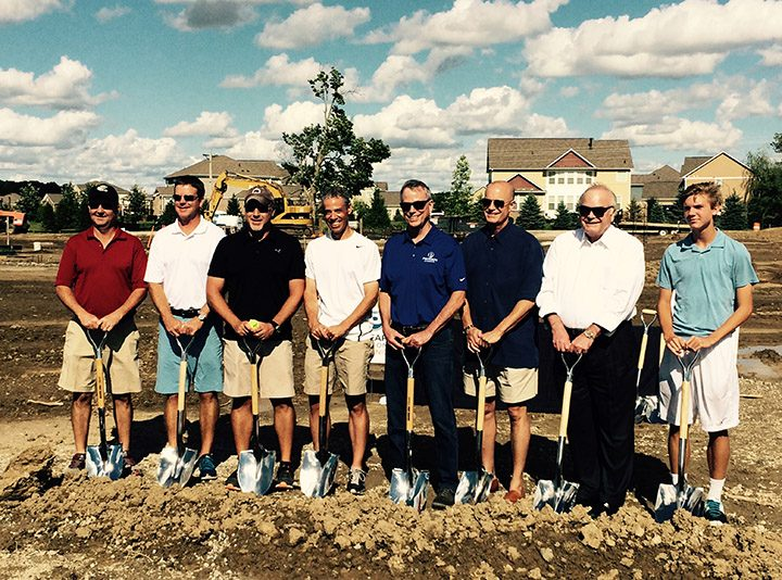 Pearson Automotive Tennis Center supporters and Zionsville Mayor Tim Haak hold groundbreaking shovels. From left, David Hunt, Tim Haak, Brent Claymon, Derek Mandel, John Pearson, John Campbell, Ray Ingham and RJ Brow. (Photo by Mark Ambrogi)