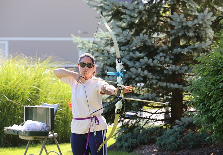 Susana Suarez practices archery in the yard at her Zionsville home. (Photo by Ann Marie Shambaugh)