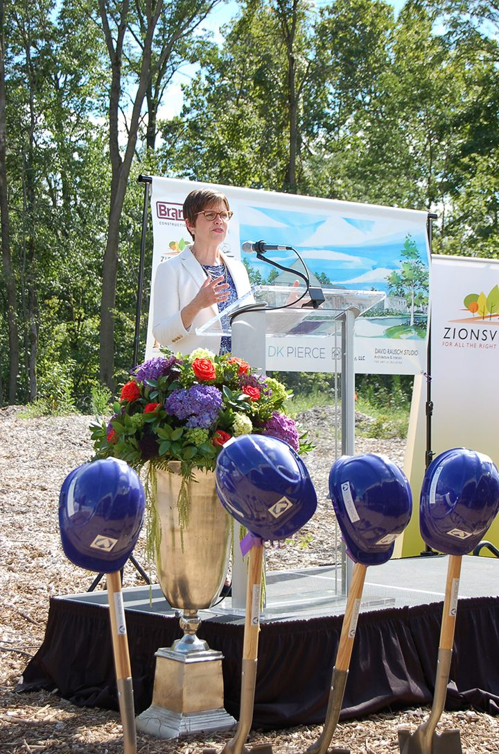 Denise Pierce speaks at the groundbreaking ceremony for DK Pierce & Associate's new headquarters in Creekside Corporate Park. (Photo by Heather Lusk)
