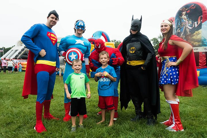 From left, Brian Peterson (Superman), Isaac Rudd (Captain America), Elliott Shreve, Steve Stone (Spider-Man), Andrew Shreve, Kyle Zerfas (Batman) and Ariel Rudd (Wonder Woman) at the St.Vincent NICU/CCN reunion Aug. 20 at Lions Park.  (Submitted photo)