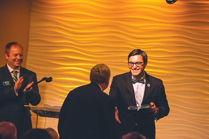 Jack Russell awards Eric Lohe with the President's Award as Tom Dooley, left, watches. (Submitted photo)
