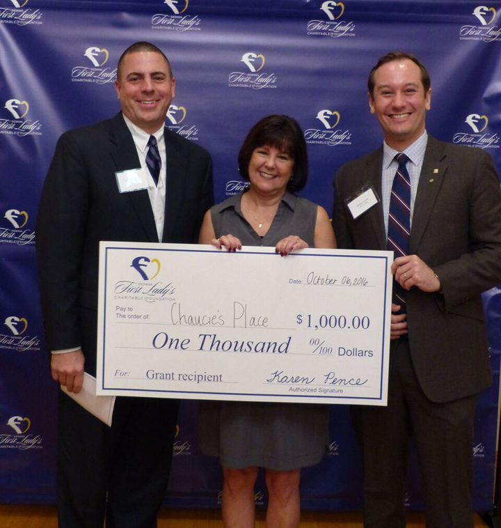 Hamilton County Prosecutor Lee Buckingham (left) and Chaucie's Place Board President Richard F. Taylor III (right) with First Lady Karen Pence at the awards reception. (Submitted photo)