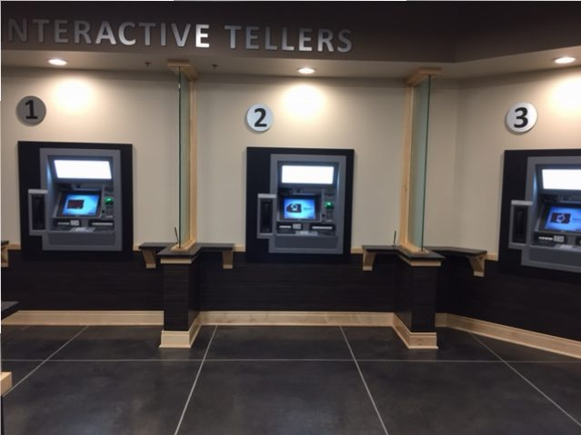 The Interactive Teller Machines at the new Carmel branch. The ITMs allow members to both see and speak with a IMCU representative through on-screen technology, while using corresponding machines for their transactions. (Photo by Nick Poust)