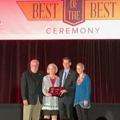 From left, CCPR Director Mark Westermeier, Business Services Director Audrey Kostrzewa and Chief Operating Officer Michael Klitzing accept an award from a representative from NRPA. (Submitted photo)