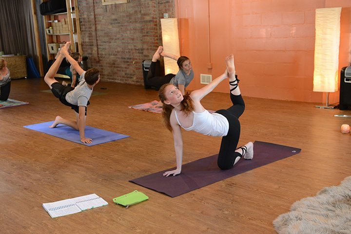Anna Limauro, 13, of Carmel teaches a yoga class at Blooming Life Yoga Studio in Zionsville. Limauro is among the youngest yoga instructors in the state. (Photo by Theresa Skutt)