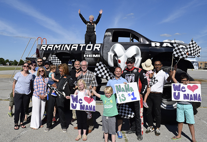 Sheryl Beerbouer stands on the Raminator, a monster truck driven by Mark Hall, as her family, Hoda and Hall stand before it. (Submitted photo courtesy of NBC/The Today Show)