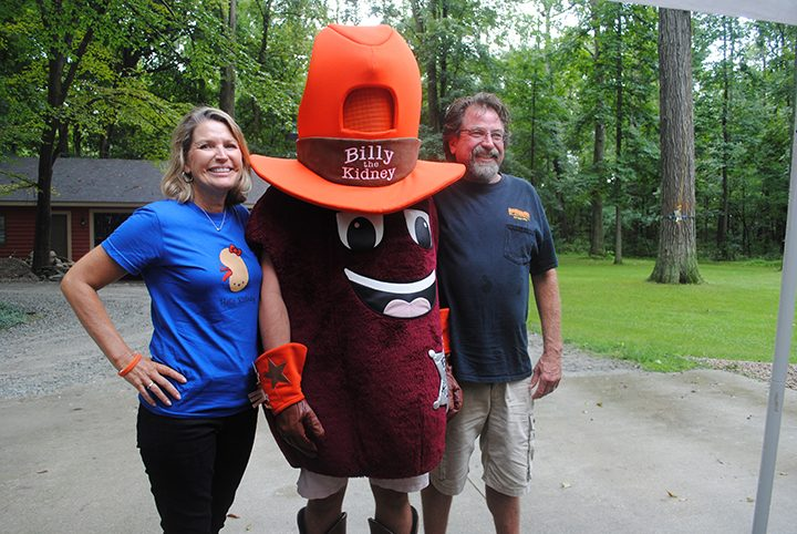 Siblings Debbie Townsend and T.J. Farrar celebrate with Billy the Kidney to recognize the siblings' 30 years of life since the transplant. (Photo by Anna Skinner)
