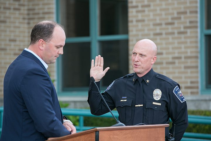 Mayor Scott Fadness swears Mitch Thompson in to his new chief position. (Submitted photo)