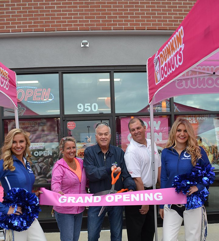 Flanked by Colts cheerleaders, Suzanne Weis, Westfield Mayor Andy Cook and John Weis at Westfield's Dunkin' Donuts grand opening. (Submitted photo)