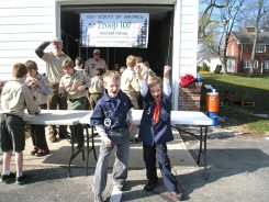 Boy Scouts sort food while Cub Scouts enjoy themselves. (Submitted photo)