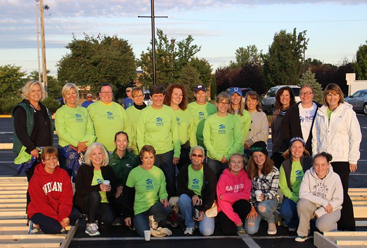 Boone County women spent a rainy Saturday morning building walls for a Habitat for Humanity home in the parking lot of the Boone Village Shopping Center. (Submitted photo)