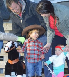 Stuart King and Hailey Zeigart with their kids, Riley King dressed as a cowboy and Charlotte King dressed as an 1980s workout girl, at a previous Boone Village Halloween party. (Submitted photo)